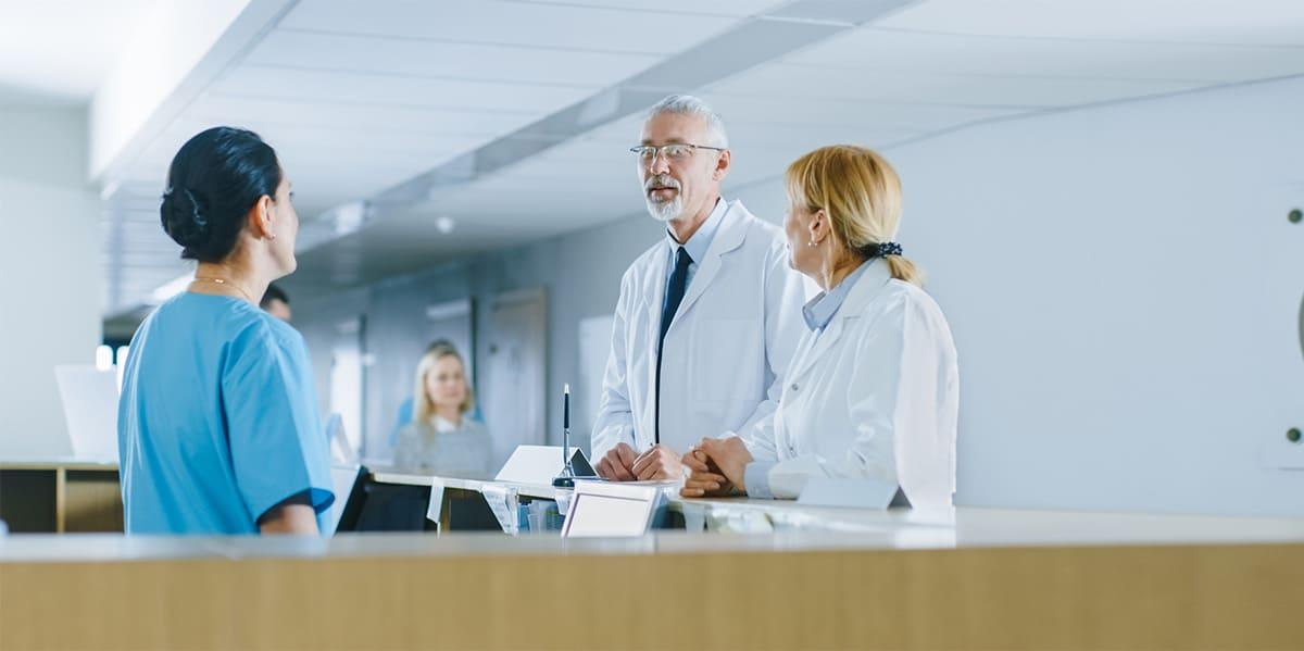doctors having conversation with nurse