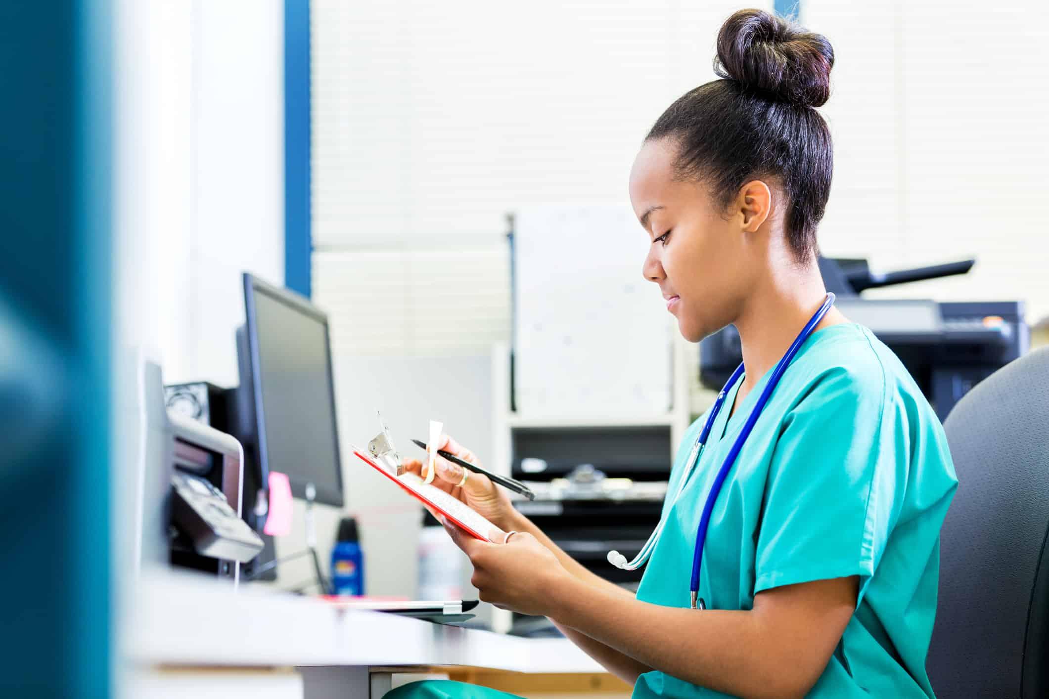 nurse checking health records
